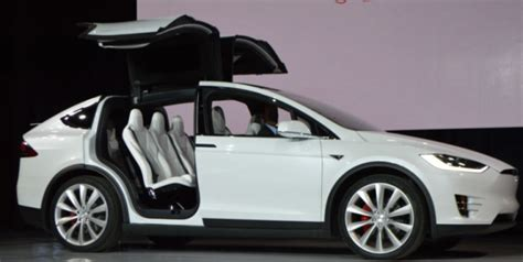 How To Open Tesla Doors Tesla Says Supplier Botched Falcon Wing Door Hydraulics