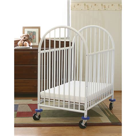 Metal Mini Crib Arched Metal Compact Crib White