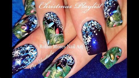 christmas robin nails painted lights and snowflake nails blue nail design tutorial