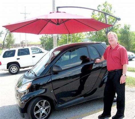 Petroleum Powered Umbrellas : personal car parasol