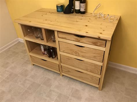 made custom built cabinet with wine cooler built in