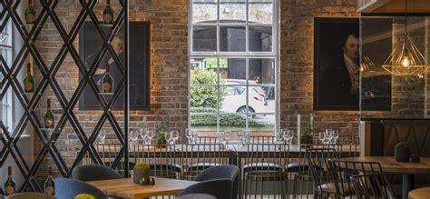 New Design Kaos Ori Rock Cafe Manchester Metallic Logo spaceinvader reveals new look for manchester city centre bar