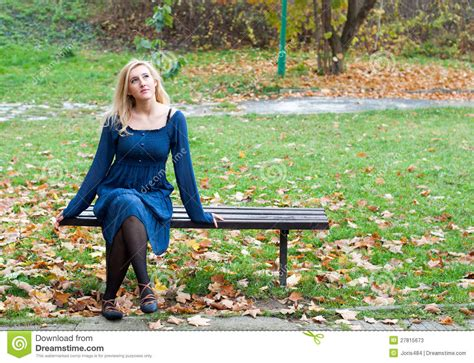 girl bench girl on a bench in the park stock photos image 27815673