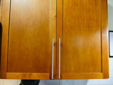 how to keep cabinet doors closed use this hack to keep your cabinet doors shut cnet