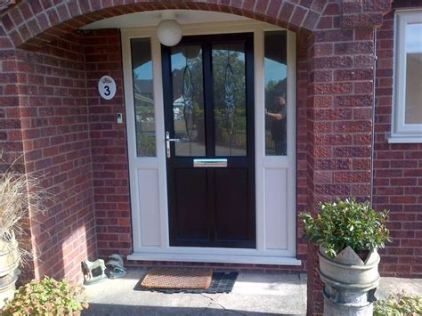 upvc front doors with side panels upvc door in rosewood with white side panels windows and