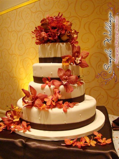 Elegant cream and brown four tier wedding cake with burnt