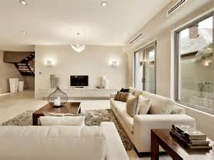 living area open plan living room using white colours with tiles bay