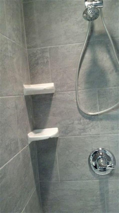 stone shower  white corner shelves traditional