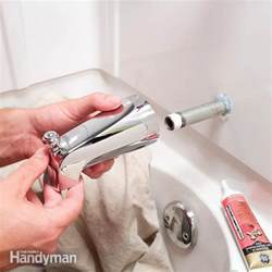 How To Fix A Leaky Faucet Bathroom How To Replace A Bathtub Spout The Family Handyman