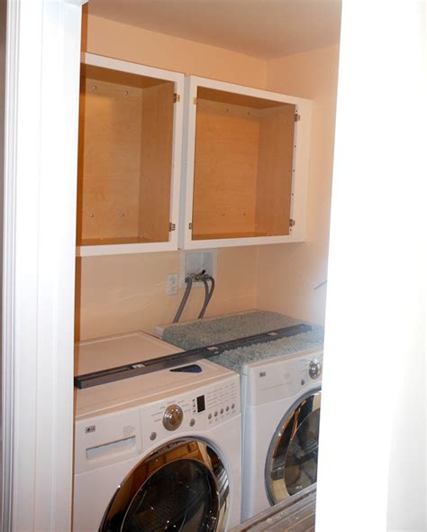 installing wall cabinets in laundry room manicinthecity