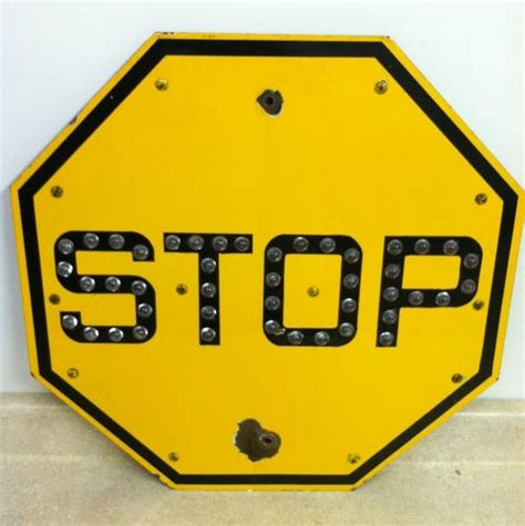 vintage yellow porcelain  stop sign  glass cat eye