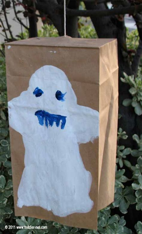 Paper Bag Ghost Craft - project painting a ghost