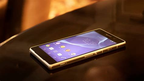 phone on the table sony branded smartphone on the table wallpapers and images