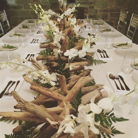 orchids  driftwood centrepiece tropical luxe wedding