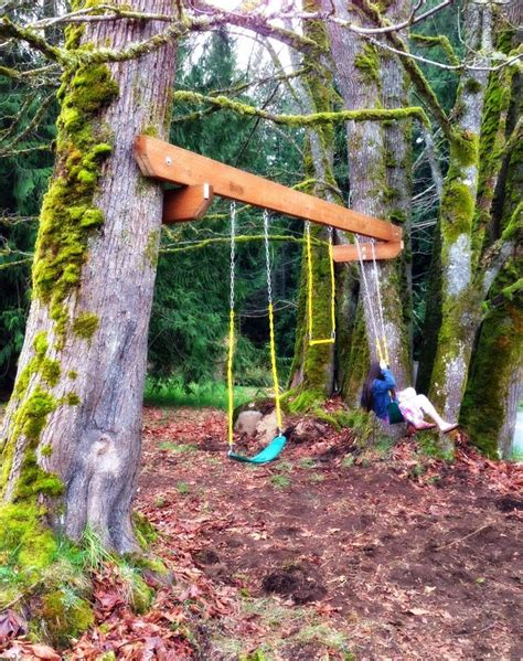 a tire swing hanging from a branch the tuscan home spring break tree swing project kids