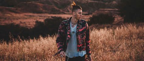 design a poster for machine gun kelly creative allies