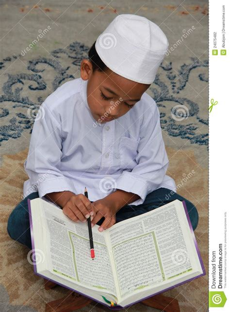 a muslim boy books muslim boy reading quran stock photography image 24075482