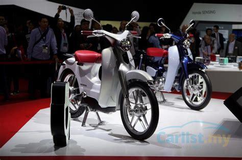tokyo  honda reinvents  iconic super cub  unveils  ev cub concept auto news