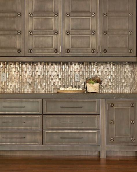nickls speisekammer distressed cabinets with an amazing metallic backsplash