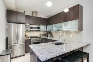 contemporary kitchen with stone tile amp glass panel in