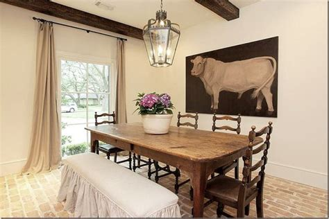 the cow dining room brick floor instead of the beams table is to die for dining spaces