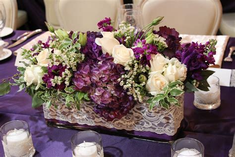 Round Wedding Table flowers eggplant   Tall arrangements