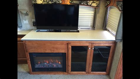 tv lift cabinet with fireplace custom rv tv fireplace storage cabinet a coach supply