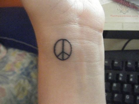 small peace tattoo peace small wrist