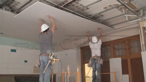 installing drop ceiling drywall suspended grid showroom drywall suspended