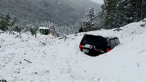 avalanche buries multiple cars  colorado  shuts