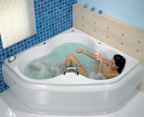 corner jacuzzi bathtub hydrotherapy backpain home renovation ireland