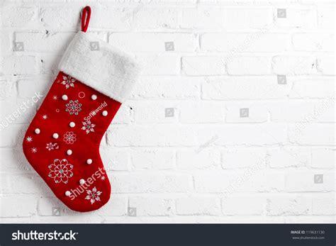hanging christmas lights on brick walls red christmas sock hanging on white stock photo 119631130