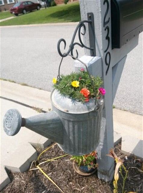 mailbox post with a watering can planter idea to