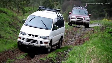 mitsubishi delica off road mitsubishi delica suzuki grand vitara 4x4 off road muddy