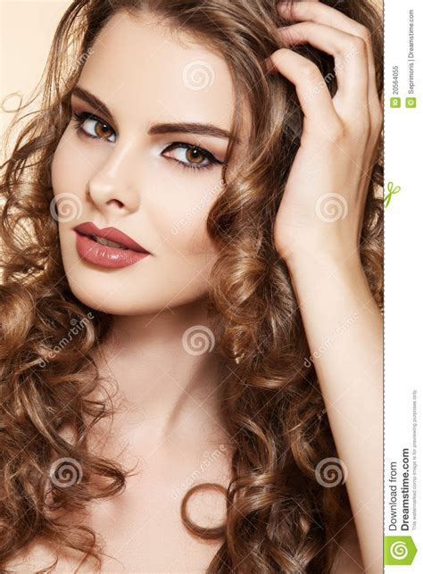 beautiful model touch  long shiny curly hair stock