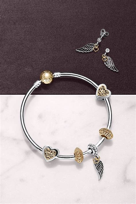 Pandora Guidance Dangle P 787 pandora s filigree wing charm and earrings with dangling 14k gold hearts are the