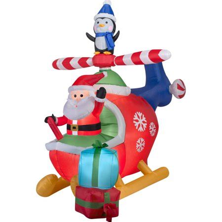 christmas yard blowups gemmy airblown inflatables santa and penguin in helicopter 8