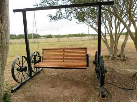 wagon wheel porch swing wagon wheel swing woodworking pinterest wagon wheels
