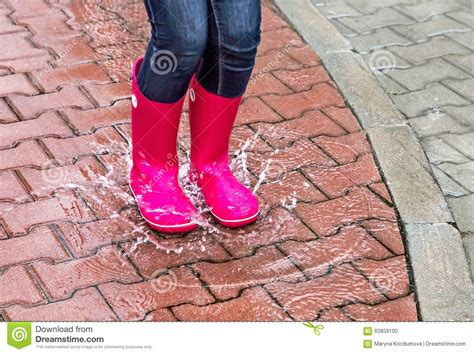 wearing rubber boots autumn protection in the wearing pink rubber