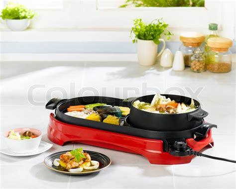 steamboat pan to i 233 n elektrisk pande til grill og madlavning karry en