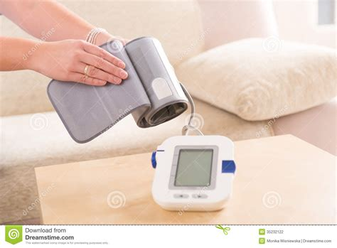 checking blood pressure at home stock photography image