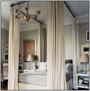 Hang Curtains From Ceiling Curtain Rods Hang From The Ceiling To Simulate A Canopy Bed Curtains Home Design Ideas