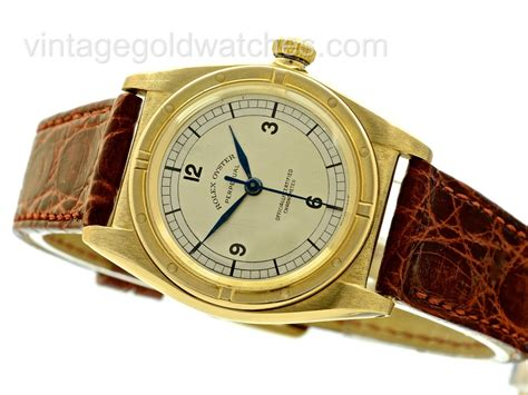 rolex back oyster perpetual 18ct gold 1947