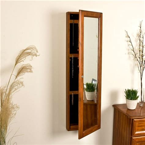 oak jewelry armoire mirror wall mount jewelry armoire cabinet and mirror in oak wood