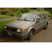 OLD PARKED CARS 1989 Geo Spectrum