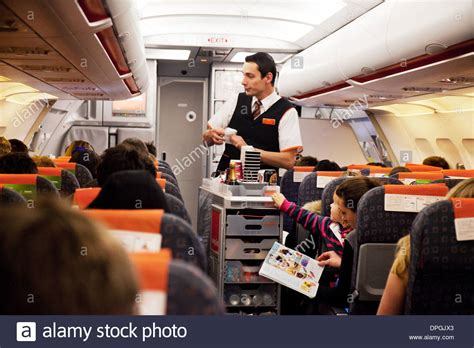 easyjet cabin easyjet airline cabin crew staff in the plane handing out