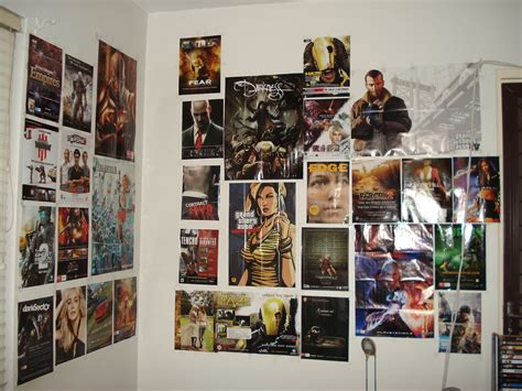 this is my bedroom s wall with game posters from thm
