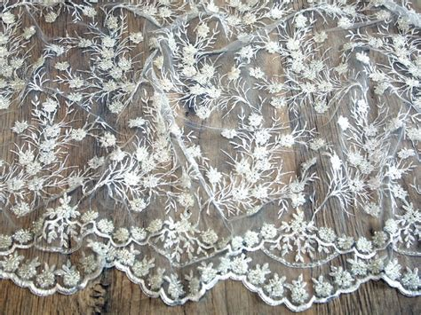 above delicate lace hand beaded with hundreds of glass beads soft beaded scalloped edge couture bridal lace fabric mv hh305