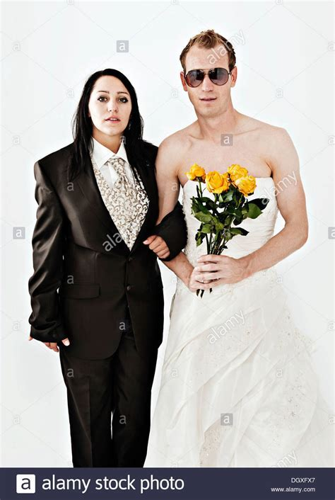 Bride wearing a suit and a groom wearing a wedding dress