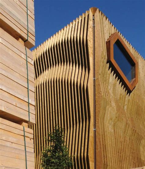 Hausfassade Aus Holz by Rippling Wood Facade Wood Facade Facades And Architects